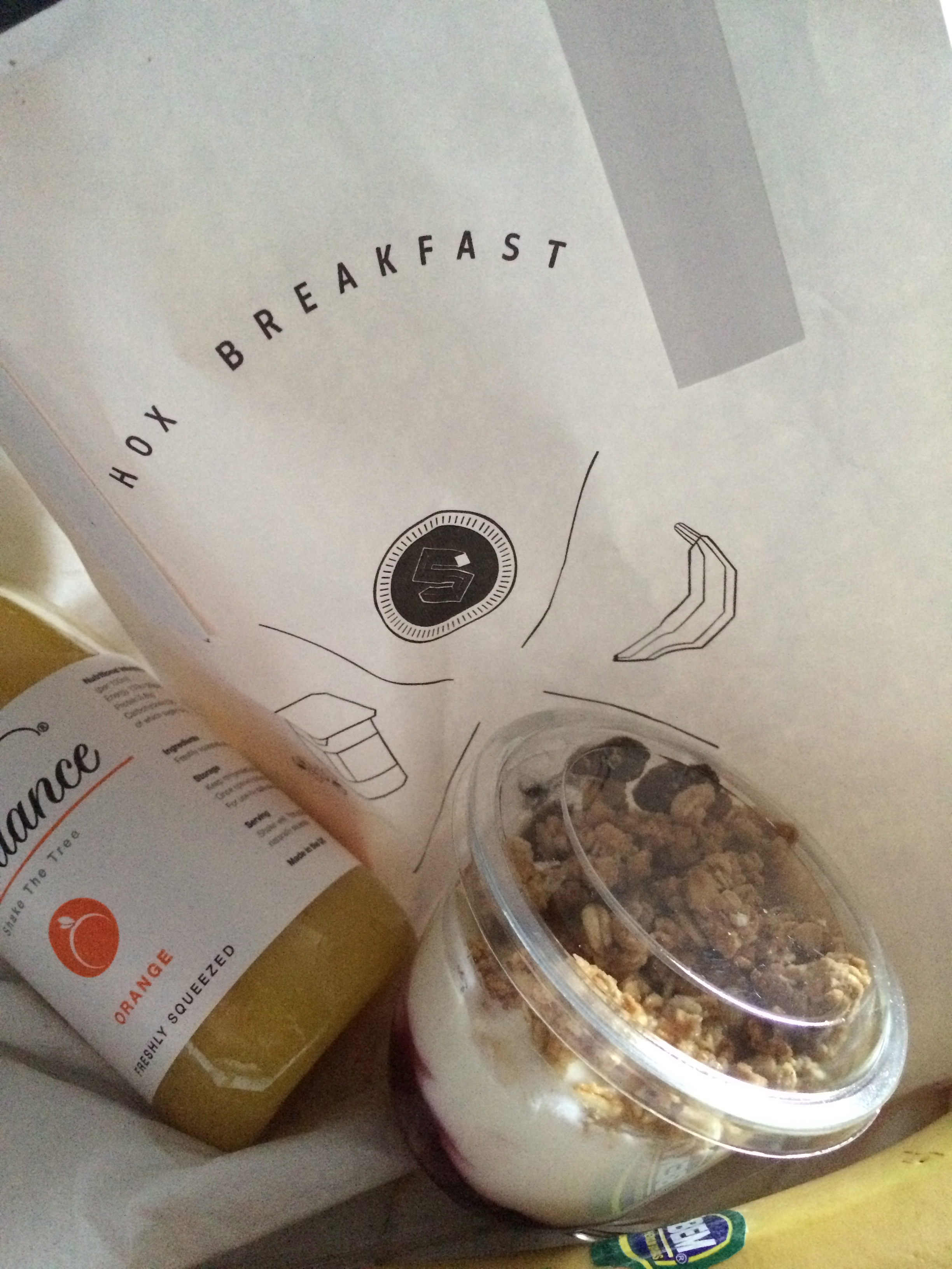 Breakfast bag delivered at your door.....fresh OJ, banana and grandola.